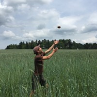 Justin Lubecki catching a bagel in the high grass