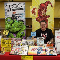 DJ Coffman, a Pittsburgh-area comics artist and occasional<i> City Paper </i>contributor,  mans his booth at 3 Rivers Comicon on Sun., May 21.