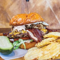 Little Ray's Fat Burger with bacon, American cheese, fried egg, crispy potatoes, lettuce, tomato and Thousand Island dressing