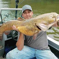 Joe Granata with a flathead catfish he caught earlier this year in the Ohio River