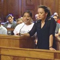 Brenda Solkez (right) translating for an undocumented immigrant speaking at a July 12 public hearing