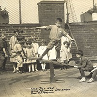Kids on the Irene Kaufmann Settlement's rooftop playground, in the Hill District, in 1924