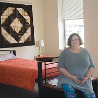 Allegheny Health Network nurse Danielle Dipre in a vacant medical respite room at Bethlehem Haven