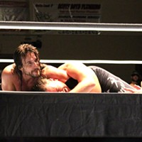 Adam Cole wears down John McChesney