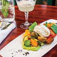 Heirloom tomato salad, with burrata cheese, avocado mousse, watercress and olives