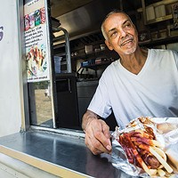 Seti Martinez serves up another Polish Boy at his food truck.