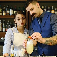Olive Beals and Michael Anderson behind the bar at Evangeline