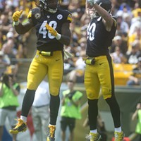 Bud Dupree and T.J. Watt celebrate a blocked pass by Watt during the first quarter.