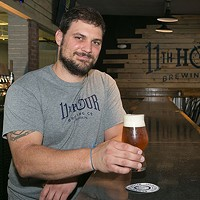 Matt McMahon behind the bar at Eleventh Hour Brewing
