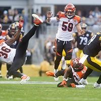 Vance McDonald cuts past a diving Shawn Williams of the Cincinnati Bengals.