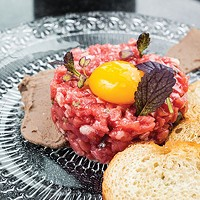 Beef tartare: New York strip, duck-liver mousse, chestnut, egg yolk and crostini