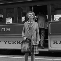 Rose (Millicent Simmonds) in the city