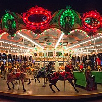 The carousel glows during Holiday Lights at Kennywood Park