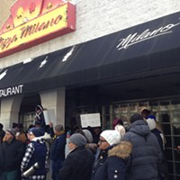 Protesters outside Pizza Milano in Uptown on Jan. 15