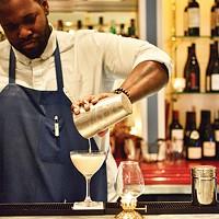 Cecil Usher prepares a Brandy Alexander behind the bar at Poulet Bleu.