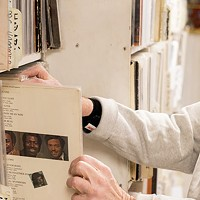 A customer browses records at the Attic Record Store in Millvale