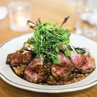 Rack of lamb with mushroom risotto, peashoots and grilled ramp salad from The Whitfield's lamb menu