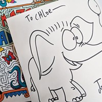 A signed copy of Pittsburgh artist Joe Wos' A-Maze-Ing Animals