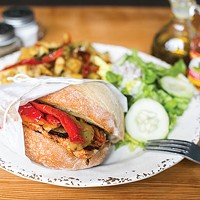 Bifana: pork loin with sautéed onions, lettuce and tomato in a garlic sauce on a Portuguese roll; served with imported peppers, Portuguese salad and home fries