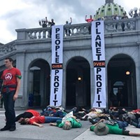 "Protesters in Harrisburg staging a ""die-in"" to protest for universal health care"