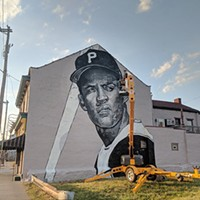 Jeremy Raymer at work on his Clemente mural