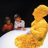 "Children marvel at ""Yellow,"" a Lego sculpture by Nathan Sawaya, at <i>The Art of the Brick</i> at the Carnegie Science Center's new PPG Science Pavilion"