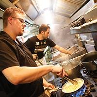 Chef John Gault prepares fettuccini Alfredo at Legends of the North Shore.