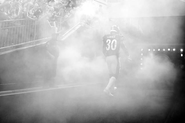 James Conner enters from the tunnel. - CP PHOTO: JARED WICKERHAM