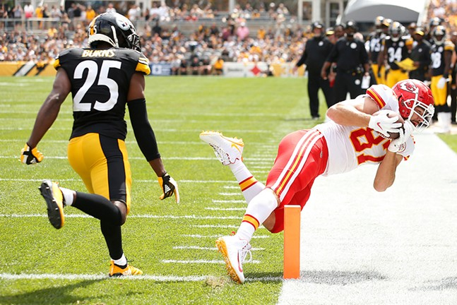 Travis Kelce of the Kansas City Chiefs makes a touchdown catch in front of Steelers Artie Burns. - CP PHOTO: JARED WICKERHAM