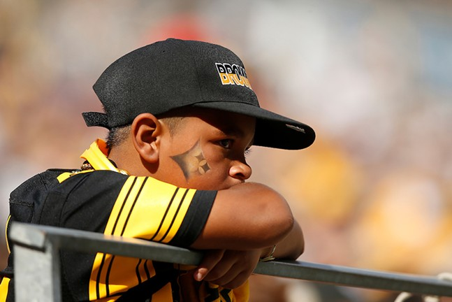 A young fan looks on during the game. - CP PHOTO: JARED WICKERHAM
