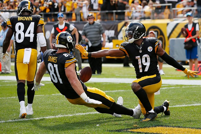 JuJu Smith-Schuster celebrates his touchdown with teammate Jesse James. - CP PHOTO: JARED WICKERHAM