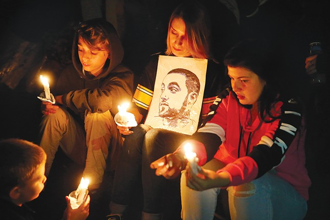 Mac Miller fans at the candlelight vigil in Blue Slide Park on Tue., Sept. 11 - CP PHOTO: JARED WICKERHAM