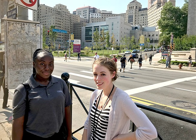 UPMC employees Ashley Smith (left) and Ellie Lalonde (right) in front of UPMC Presbyterian in Oakland - CP PHOTO: RYAN DETO