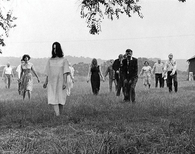 Ghouls in field in Night of the Living Dead - FILM STILL: IMAGE TEN, INC.