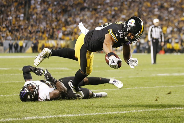 James Conner dives in for a two-point conversion. - CP PHOTO: JARED WICKERHAM