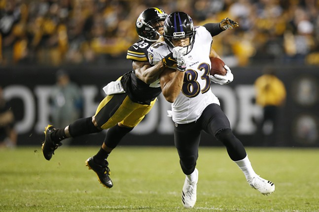 Willie Snead of the Baltimore Ravens avoids a tackle by Joe Haden. - CP PHOTO: JARED WICKERHAM