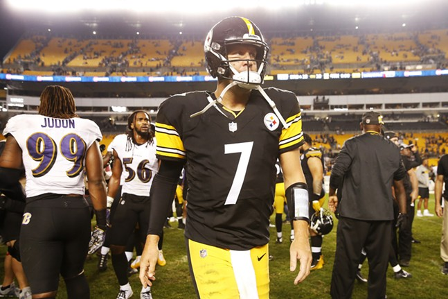 Ben Roethlisberger walks off of the field in defeat. - CP PHOTO: JARED WICKERHAM