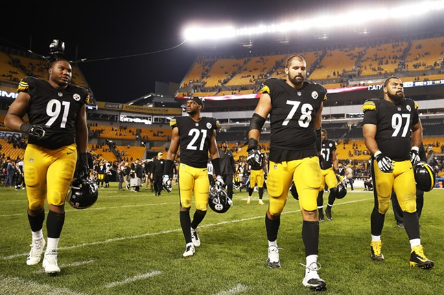 Members of the Steelers leave the field after losing 26-14. - CP PHOTO: JARED WICKERHAM