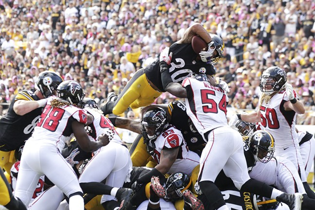 James Conner flies over the Atlanta defense for his first of two touchdowns. - CP PHOTO: JARED WICKERHAM