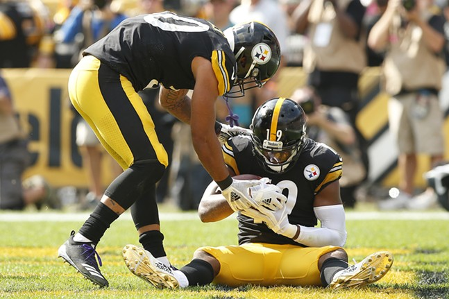 JuJu Smith-Schuster pretends to give birth to a football as his teammate James Conner delivers in in their touchdown celebration. - CP PHOTO: JARED WICKERHAM