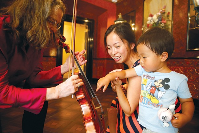 The Pittsburgh Symphony Orchestra participates in a sensory-friendly concert at Heinz Hall. - CP PHOTO: JARED WICKERHAM