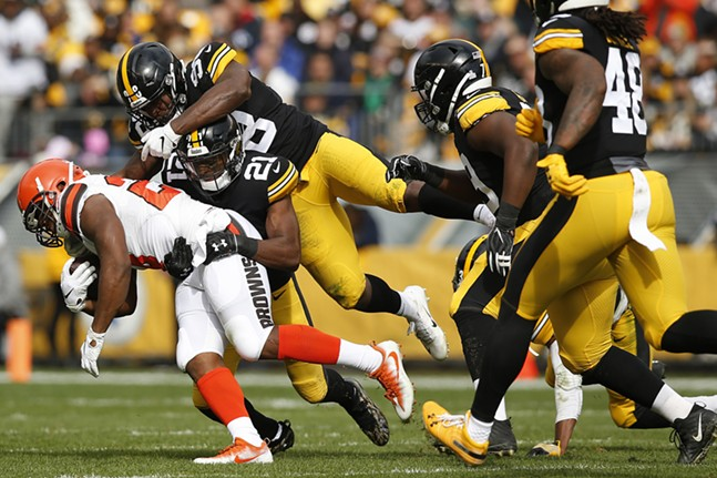 Duke Johnson #29 of the Cleveland Browns is gang tackled by Sean Davis #21 and Mike Hilton #28 of the Steelers. - CP PHOTO: JARED WICKERHAM