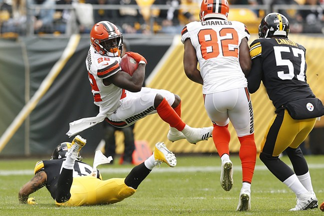 Jabrill Peppers #22 of the Cleveland Browns is upended on a punt return by Roosevelt Nix-Jones #45. - CP PHOTO: JARED WICKERHAM