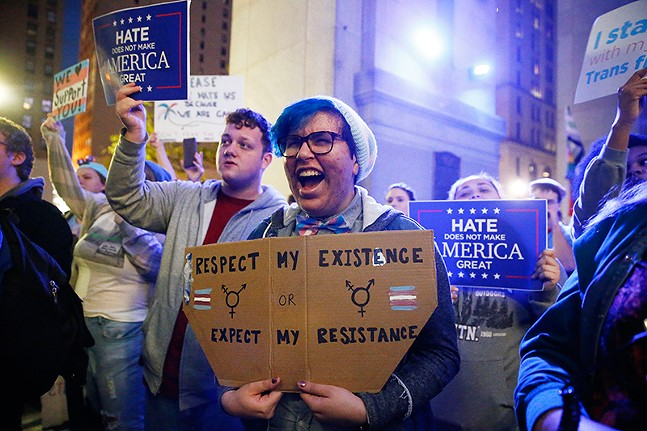 """Respect my existence"": People hold up messages in support for transgender rights during a Trans-Rights Rally in Downtown Pittsburgh on Thu., Nov. 2. - CP PHOTO: JARED WICKERHAM"