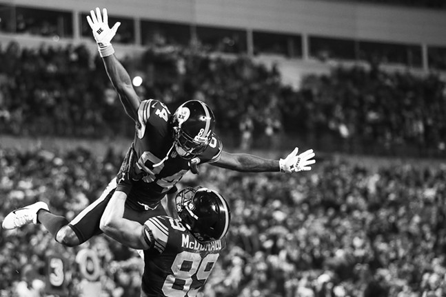 Antonio Brown of the Pittsburgh Steelers is lifted into the air by Vance McDonald following McDonald's touchdown. - CP PHOTO: JARED WICKERHAM