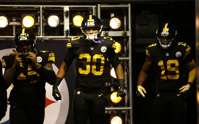 James Conner enters the field with Roosevelt Nix-Jones and JuJu Smith-Schuster. - CP PHOTO: JARED WICKERHAM