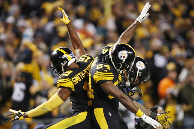 JuJu, AB, and Conner celebrate yet another score. - CP PHOTO: JARED WICKERHAM