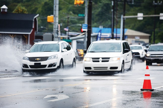 Vehicles drive down Route 51 in the South Hills. - CP PHOTO BY JARED WICKERHAM