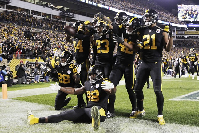 The Pittsburgh Steelers defense celebrates following Haden's interception. - CP PHOTO: JARED WICKERHAM