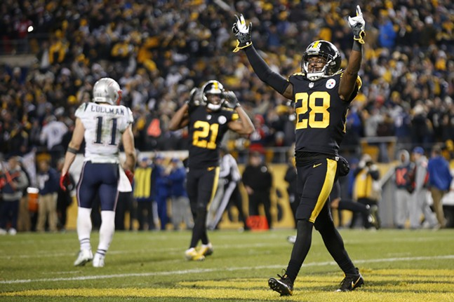 Mike Hilton celebrates the 17-10 win against the Patriots. - CP PHOTO: JARED WICKERHAM